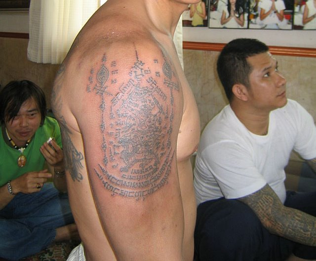 Get tattooed by a holy man, Ajarn Hnuu Ganpai: Angelina Jolie got two